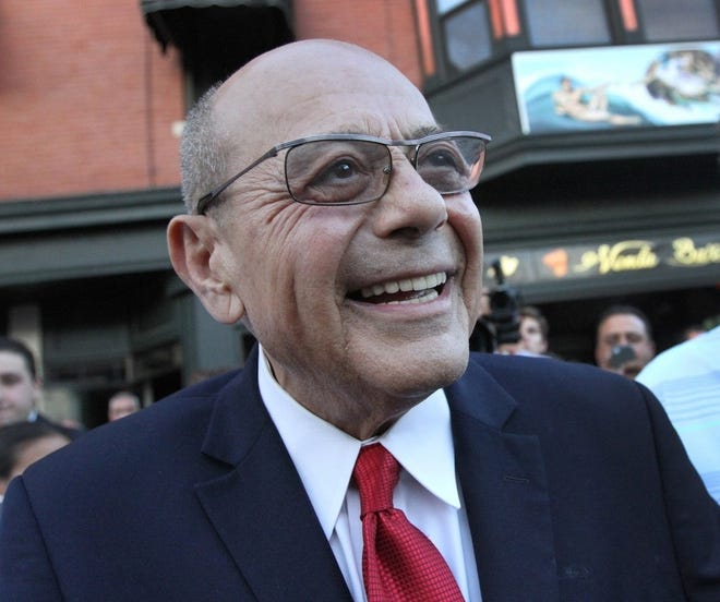 Former Providence Mayor Vincent A. Cianci celebrates his announcement that he is running for mayor during a night of dining and meeting supporters and friends at DePasquale Plaza in Providence's Federal Hill neighborhood. The Providence Journal/Bob Thayer