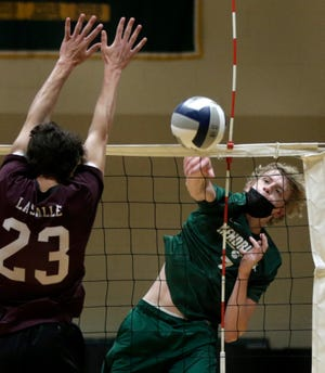 Outside hitter Dylan McClung of Hendricken powers a blast past La Salle's Christopher Gannon in a June match.