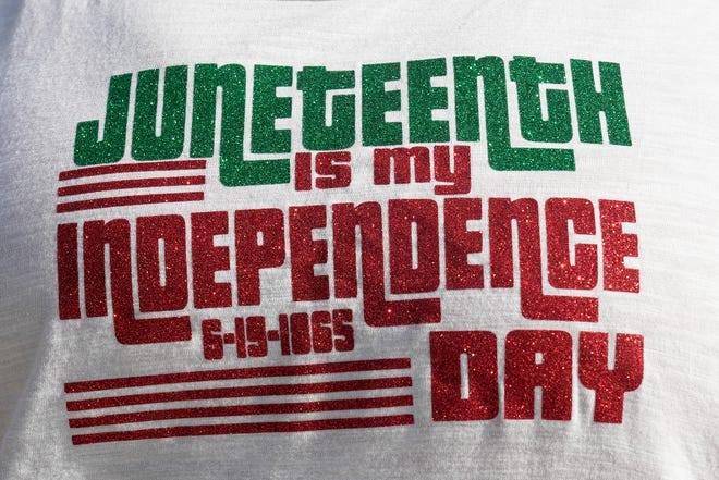 A shirt recognizes Juneteenth during a celebration in Newport.