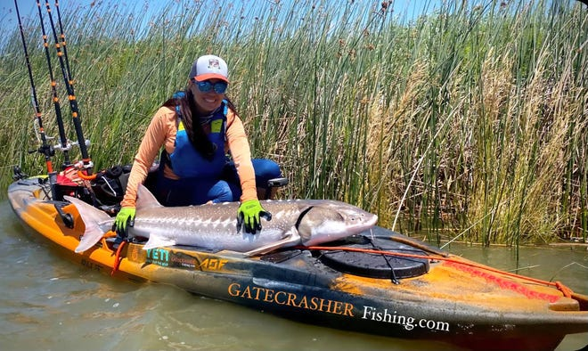 Virginia Salvador caught and released this 59 inch sturgeon while fishing from her kayak in Montezuma Slough on June 7.