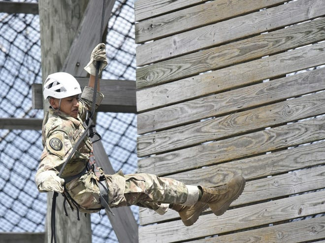 Waynesville High School Junior ROTC Cadet Roberto Arzabala rappels down the 45-foot Warrior Tower at Training Area 136. A group of 27 cadets visited Fort Leonard Wood June 8 and 9, for their annual JROTC Cadet Leadership Challenge. (Photo by Brian Hill)