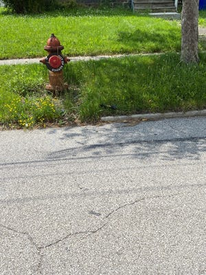 This hydrant on Pratt Street has been tagged as out of service because it lacks sufficient water pressure to put out a fire. Officials are seeking grant funding to improve the water pressure and replace the hydrant.