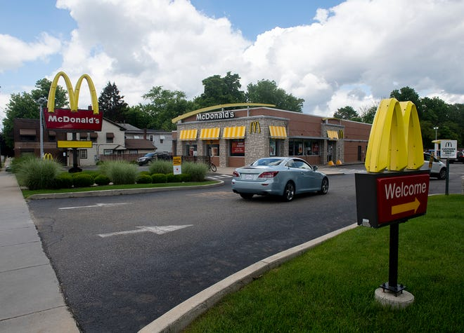 A Ravenna woman was charged with assaulting a manager and employee a the West Main Street McDonald's restaurant on Monday.