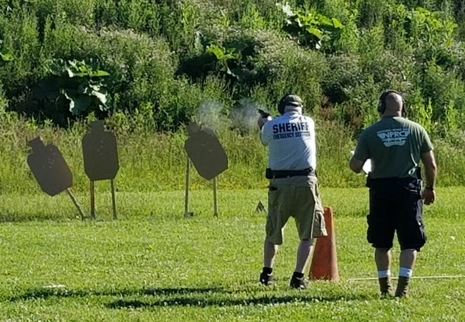 Canton Police Officer Kevin Sedares, right, serves as range safety officer for Jerry Chapman. Chapman, 79, is a retired Middletown police officer who competed Tuesday in the pistol (combat/steel) portion of the Ohio Police & Fire Games being held in Stark County.