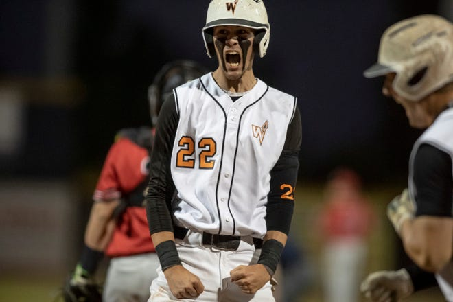 Winnebago's Jason Buhl reacts after scoring the tying run in the top of the sixth inning against Elmhurst Timothy Christian in a Class 2A baseball supersectional at Rivets Stadium on Monday, June 14, 2021, in Loves Park. Winnebago took a brief lead but Timothy Christian won 5-2.