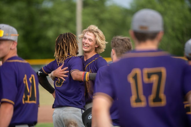 Gabe Roessler, right center, hugs Bryce Goodwine (3) as Hononegah celebrates winning its first sectional baseball title on June 11. Hononegah finished fourth in state in baseball and won the NIC-10 title in six different sports en route to winning its 11th consecutive All-Sports trophy.