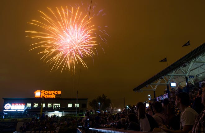 Fans watch fireworks at Four Winds Field after the Lansing Lugnuts at South Bend Cubs game  June 30, 2017.