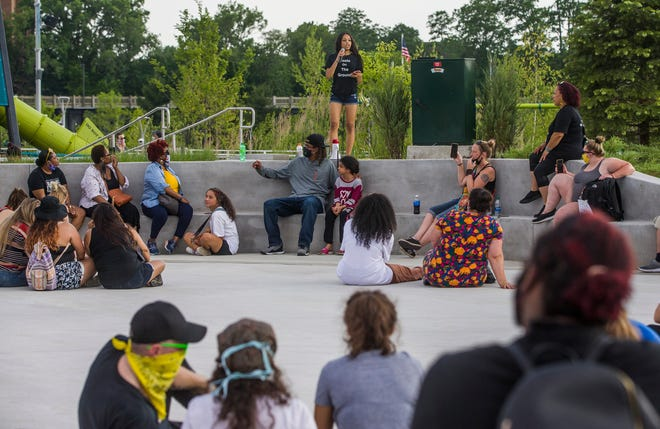 Antonia Martinez reads poetry as a crowd looks on during a Juneteenth celebration last year at Howard Park in South Bend.