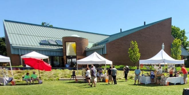 Customers explore the works the day's featured artists during a Summer Art Market event at Krasl Art Center in St. Joseph. The 2021 schedule begins Saturday and continues July 24, Aug. 28 and Sept. 25.