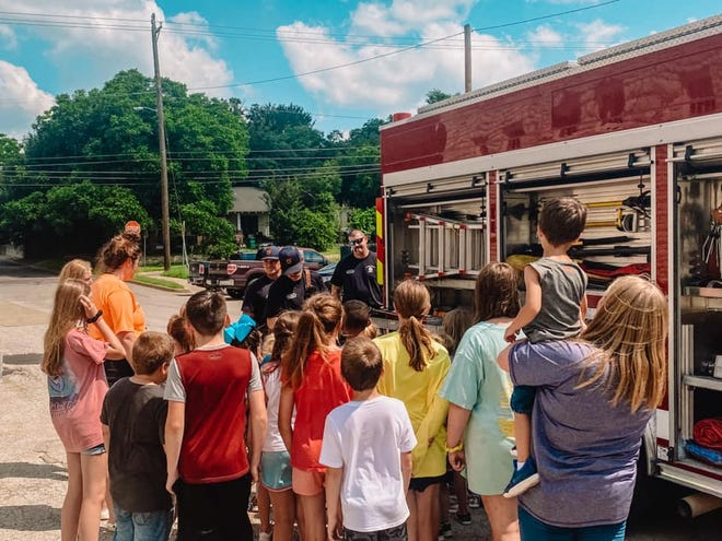 Summer campers with the Stephenville Parks and Rec Department learn about the various parts and functions of a fire engine during a visit on Tuesday afternoon from Stephenville Fire Department firefighters.