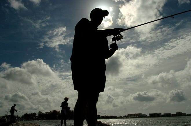 A fisherman fishes off the south Jetty in Venice, a popular fishing spot.