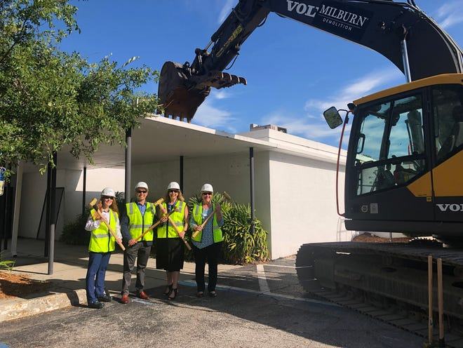Pictured from left: Susan Fallis, director of nursing for SMH Behavioral Health Services; Matthew Thomas, MD, medical director of inpatient psychiatric services at SMH; Lorrie Liang, president of the SMH-Sarasota campus; and Terry Cassidy, executive director of SMH Behavioral Health Services, take part in the first day of demolition of Bayside East on June 8.