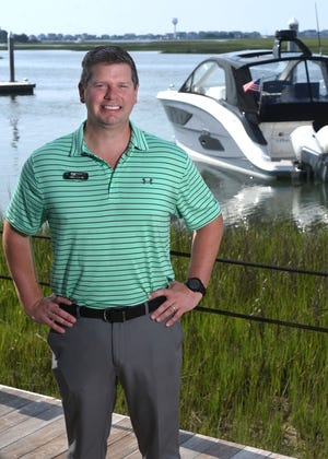 Chris Hoenig, Yacht and Boat Sales Consultant with MarineMax, stands at the business in Wrightsville Beach, N.C., Tuesday, June 15, 2021. Hoenig is one of the StarNews 40 Under 40 honorees for 2021.