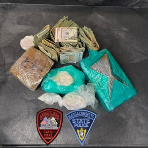 """A portion of drugs and cash seized by authorities during """"Operation Lunch Break"""" on June 11 when multiple arrests were made in New Bedford connected with the Geraldo Rivera Drug Trafficking Organization."""