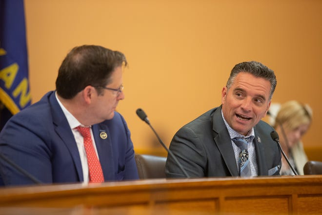 Republican legislators discuss ending the state's COVID-19 emergency declaration during a May 26 meeting at the Statehouse. Members opted to let the order expire Tuesday.