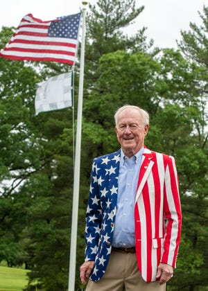 John Budd stands outside Tatnuck Country Club in front of the flagpole dedicated in his honor last week.