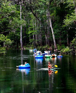 Tubers and paddlers make their way down the Ichetucknee River in Fort White.