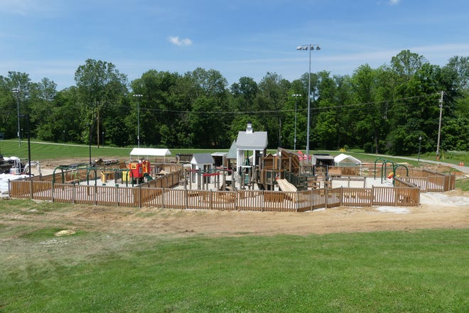 The numerous volunteers for the PLAYoli Playground Community Build have finished their work on the playground.