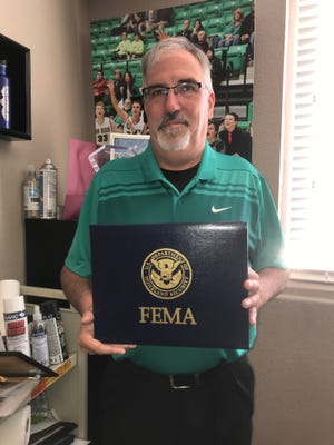 Crawford County Emergency Management Director Brad Thomas holds the plaque he received for taking part in the Emergency Management Basic Academy held last year in Jacksonville. The academy was sponsored by the Arkansas Department of Emergency Management, the Federal Emergency Management Agency and the Emergency Management Institute.