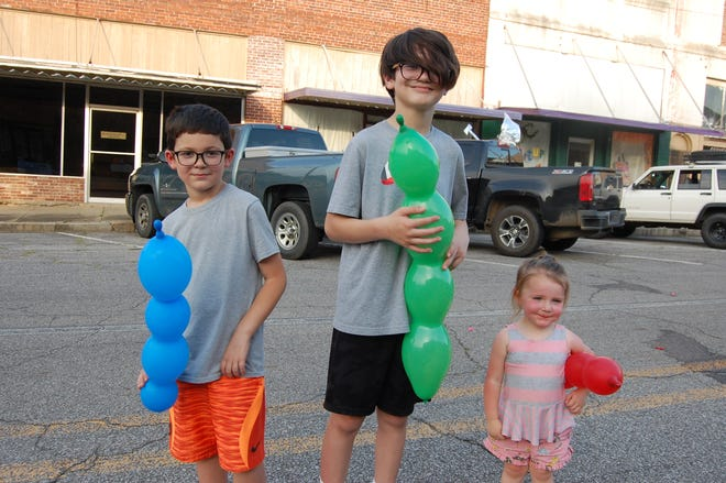 Among those enjoying the Friday Nights on Main Street event held Friday, June 11, at Mulberry were siblings (from left) Silas Kling, Jensen Kling, and Nora McCleod from Muldrow, Oklahoma.