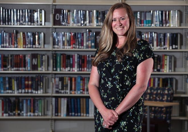 Amy Warren officially will take over Aug. 1 as the principal at Canal Winchester High School. She is pictured in the school's library.