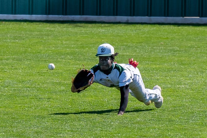 Waxahachie senior centerfielder Xavien Thompson dives for a sinking liner during a game against Birdville in the Robert Dulin Memorial Tournament in March. Thompson has been selected to the 2021 Class 6A Elite Team by the Texas High School Baseball Coaches Association.