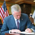 Baker signs bill extending to-go cocktails, remote meeting policies