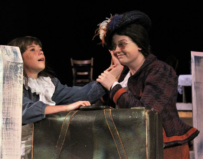 """Helen (Catelyn Cervantes) touches the face of a newcomer to the Keller house, Annie Sullivan (Graci Melbourne) in this rehearsal scene from McMurry University's summer show """"The Miracle Worker,"""" on stage this weekend."""