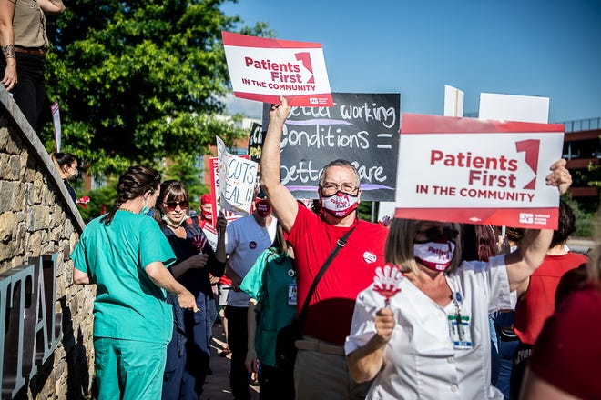 Hundreds of nurses and community members filled the sidewalks and seating area surrounding Mission Hospital during a picket on Tuesday, June 15, 2021. National Nurses Organizing Committee-North Carolina announced a tentative contract agreement on July 1.