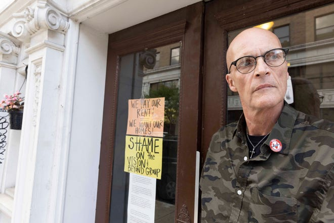 Tim Reed, 61, stands outside his Downtown apartment building at 7 W. Court Street on Tuesday, June 15, 2021. Reed has lived there for 19 years. He said that he and other residents were given a 30-day notice to vacate the property.