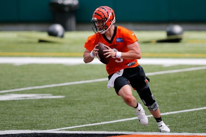 Bengals quarterback Joe Burrow scrambles during a minicamp practice at Paul Brown Stadium in Cincinnati on Tuesday.