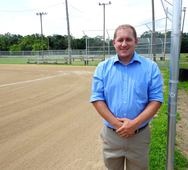 Isaac Bush, executive director of Kids America, at one of three renovated softball fields at Lake Park. Work was also done on the concession stand. Bush hopes they can revitalize two other adjacent fields and do more upgrades like new lighting and outfield fencing.