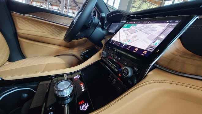 The lifted console screen and rotary shifter and things of beauty.