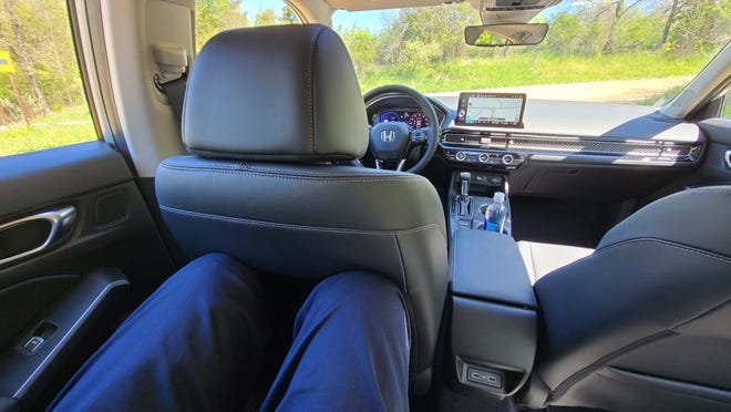 """Long, 6'5"""" Detroit News auto critic Henry Payne could comfortably sit behind himself in the 2022 Honda Civic rear seat."""