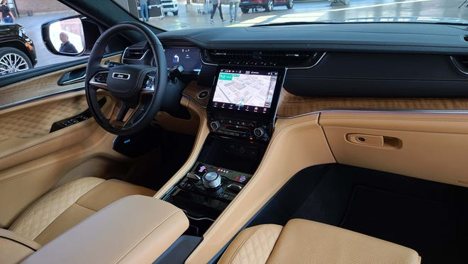 The interior of the 2021 Jeep Grand Cherokee L is all-new with a focus on a thin, lifted, digital console screen.