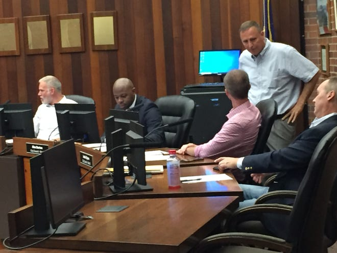 All nine Evansville City Council members gathered in person Monday evening for the first time since the coronavirus pandemic hit in spring 2020. There were no barriers between their desks, and audience seating was back to normal. From left are councilors Zac Heronemus, Alex Burton, Justin Elpers, Jim Brinkmeyer and Jonathan Weaver.