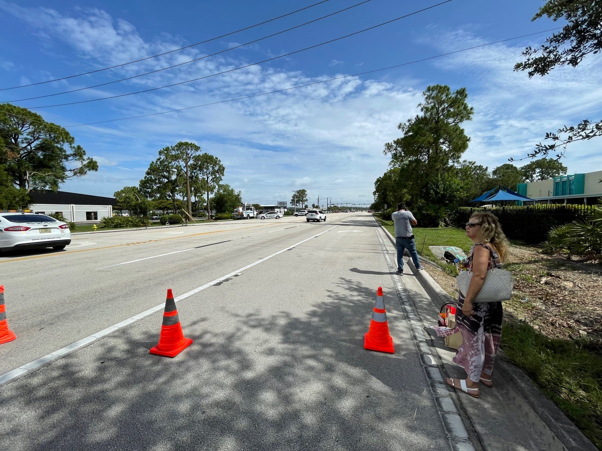 Shattered power pole with downed utility lines shuts down all of Metro Parkway in Fort Myers 2