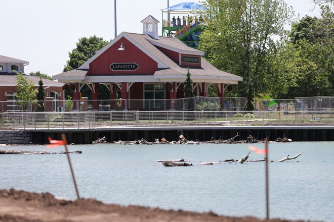 Water flows through the Columbian Park Lagoon as the Lafayette Parks Department refills the newly renovated lagoon, Monday, June 14, 2021 in Lafayette.