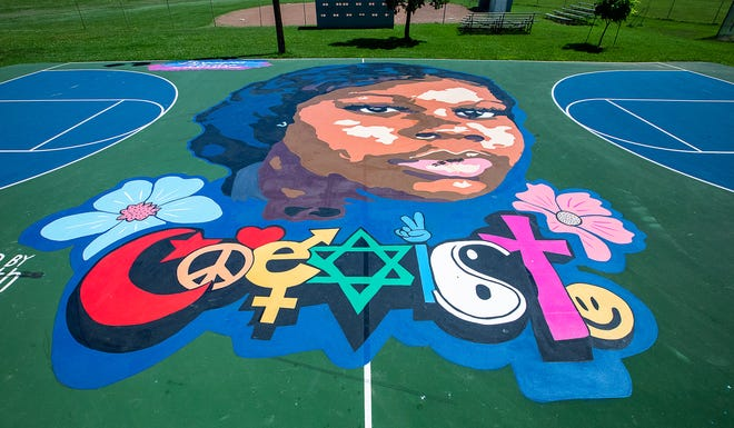 A mural of Breonna Taylor adorns the basketball court in Lannan Park in the Portland neighborhood. June 15, 2021