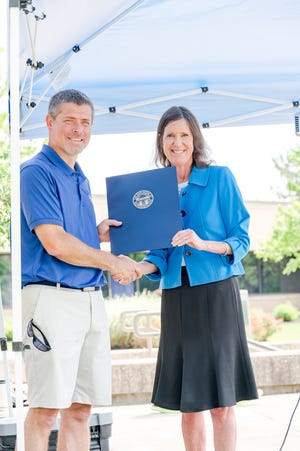 Marion Technical College President Ryan McCall poses with Rep. Tracy Richardson (R-Marysville) at the Big Tent Event Saturday, June 12, 2021 on the MTC campus. The two introduced the new school mascots.