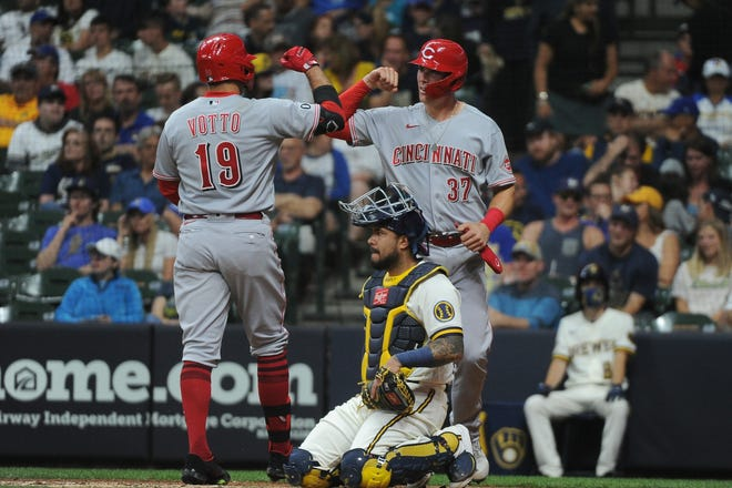 Reds first baseman Joey Votto is congratulated by catcher Tyler Stephenson after Votto's home run against the Brewers in the seventh inning at American Family Field.