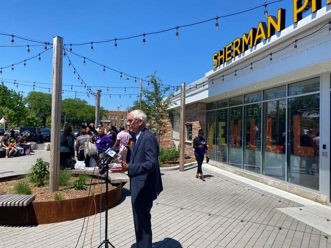 Gov. Tony Evers speaks to the press following a tour of Sherman Phoenix in Milwaukee's Sherman Park neighborhood.