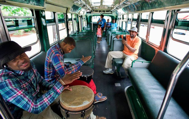 Drummers aboard the historic bus at the Rosa Parks Museum during Juneteenth.