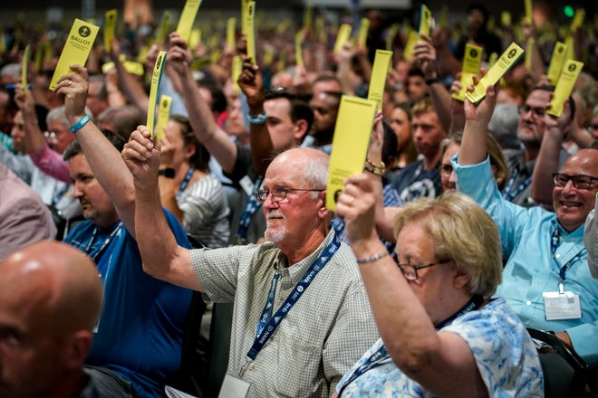 Southern Baptists vote on a resolution during the annual Southern Baptist Convention meeting at Music City Center in Nashville, Tenn., Tuesday, June 15, 2021.