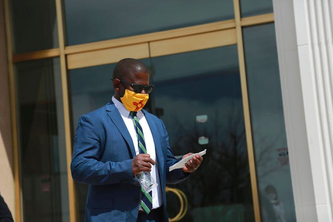 In this April 5, 2021, file photo, New Mexico Education Secretary Ryan Stewart prepares to switch masks outside the state Capitol in Santa Fe, New Mexico. New Mexico education officials accepted a federal decision barring them from taxing millions in federal aid sent to school districts serving tribal areas and military bases. Stewart said Tuesday, June 15 that the state will not appeal the decision because it would likely lose.