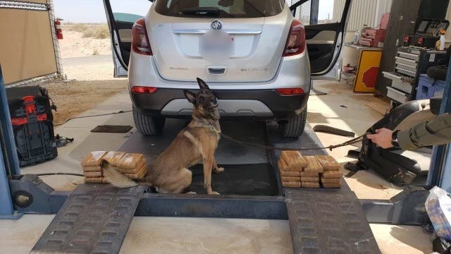 U.S. Customs and Border Protection agents found nearly 60 pounds of cocaine stowed in a hidden compartment underneath a vehicle at a checkpoint near Salton City on Monday.