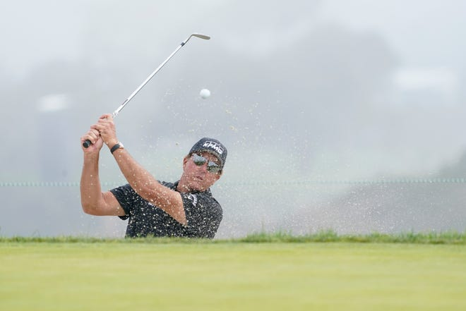 Jun 14, 2021; San Diego, California, USA;Phil Mickelson hits from a sand trap on the 12th green during a practice round of the U.S. Open golf tournament at Torrey Pines. Mandatory Credit: Michael Madrid-USA TODAY Sports