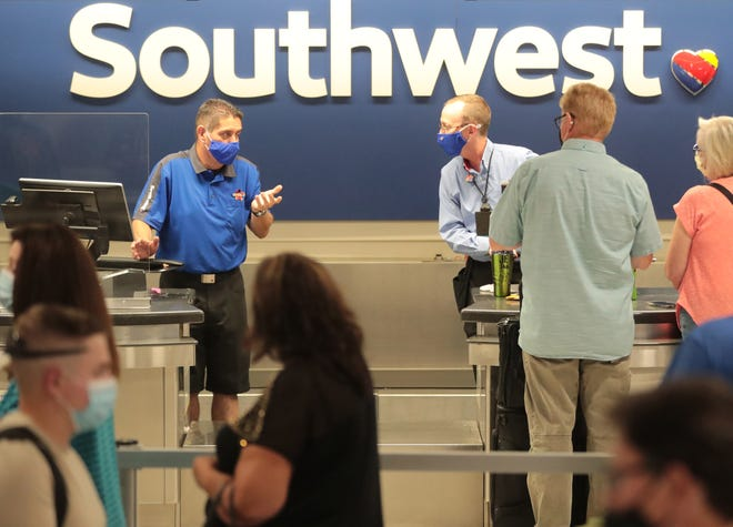Southwest Airlines employees help customers at Phoenix Sky Harbor Airport on June 15, 2021. The airlines experienced network connectivity issues which resulted in 500 flights canceled nationwide.