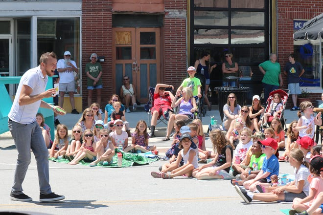 """M.O.M. in Port Clinton recently became """"Magic on Madison"""" as it hosted a show by Cleveland-based magician Michael Mage, drawing a big crowd of families downtown."""