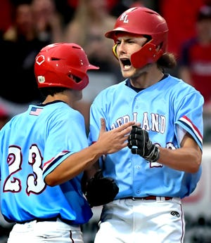 Red Land's Benny Montgomery celebrates with Cooper Artley as Montgomery scores against Manheim Central in a PIAA Class 5-A baseball semifinal at PeoplesBank Park Monday, June 14, 2021. Red Land went on to win 8-0. Bill Kalina photo